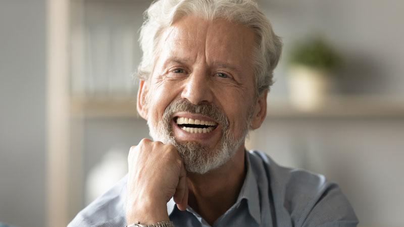 man with implanted dentures